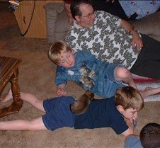 Peanut sleeps on Danny; Dad, Matt, Nick