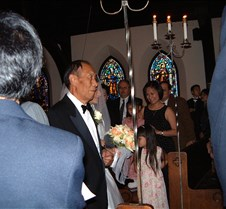 Alice and her father walking down aisle
