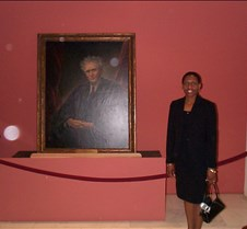 Karen with portrait of Chief Justice