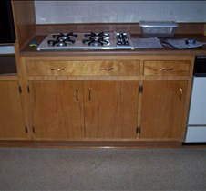 Cabinet under the cooktop