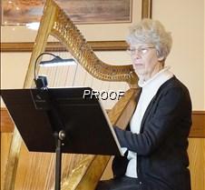Judi Dahlseng playing harp