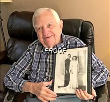 Harold holding wedding pic