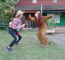 Cowardly Lion scares Scarecrow