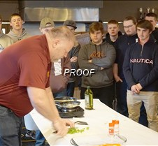 Stacy teaches boys how to cook
