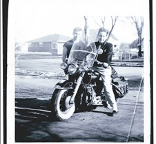 Motorcycle and two boys