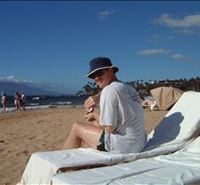 Brad on Beach putting on lotion Maui