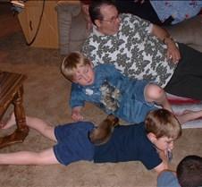 Peanut sleeps on Danny; Dad, Matt, Nick
