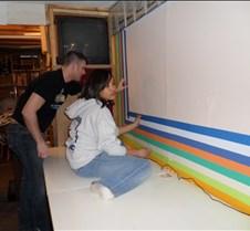 Eric & Vanessa Taping Wall
