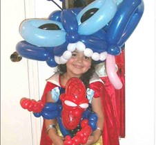 Angel with her party hat and spiderman