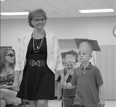 Kindergarten grad walking down
