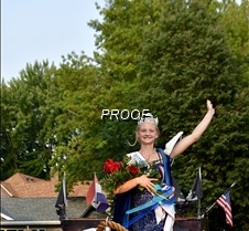 Queen Emma waves to the crowd