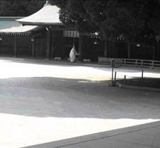 monk in full dress outside temple 2