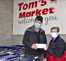 Tom's $5,000 donation to food shelf