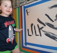 Lily writes her name and smiles