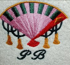 Japanese fan on towel with initials