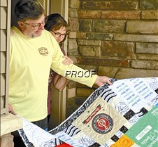 Moeller holding quilt