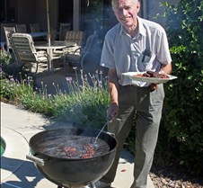 Bill Turkel BBQing Hamburgers