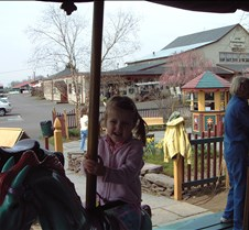 Caitlin on carousel 2 20010421