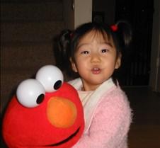 Kristen with Elmo doll