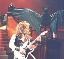 Jake E Lee bat in background