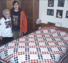 with grandma and the quilt she made for