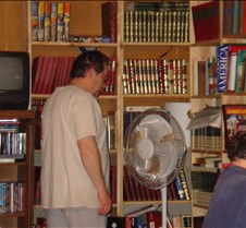 Dad, Bart looking in books