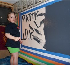 Lily paints Patty's name too