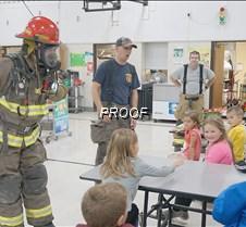 Firefighter shines the flashlight