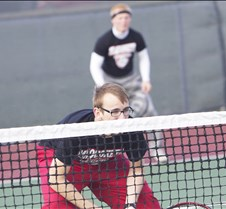 jack rolling looks over the net