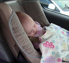 Adi sleeping in the car