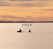 ice fishing at sunset