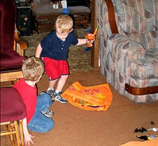 2004 10 29  Grandson's at Grandma M's... Boys came to spend the day with Grandma and Jake was around too, so you see the boys at play... One photo kind'a tells how the day went, Austyn is standing by the stove, can you guess where the kitten is by his face??? Bet you can... haha.