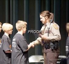 Officer McCallum handing out certificate