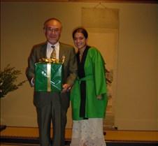 President Osake taking his present.