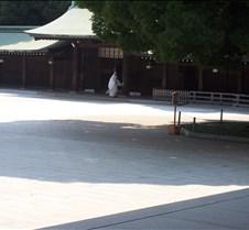 monk in full dress outside temple 1