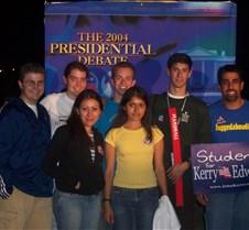 Posing in Front of Debate Sign