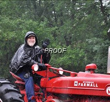 Rain soaked tractor driver