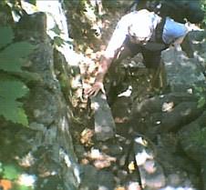 John climbing treacherous steps