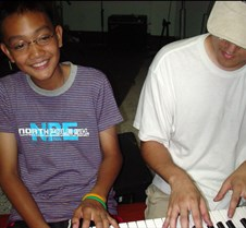 sung and kid at piano