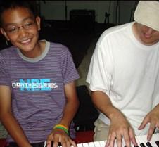 sung and kid at piano