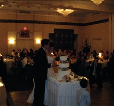 Ed and Alice cutting cake 3