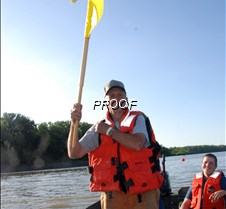 Flagman in boat