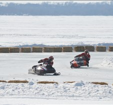 snowmobile racing-two on curve