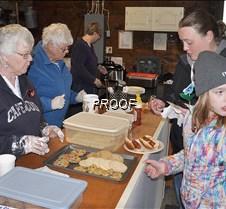 Serving hotdogs, lefse, cookies