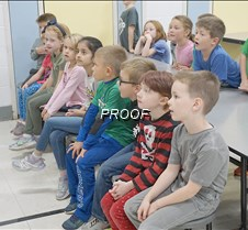 Students listening to firefighters